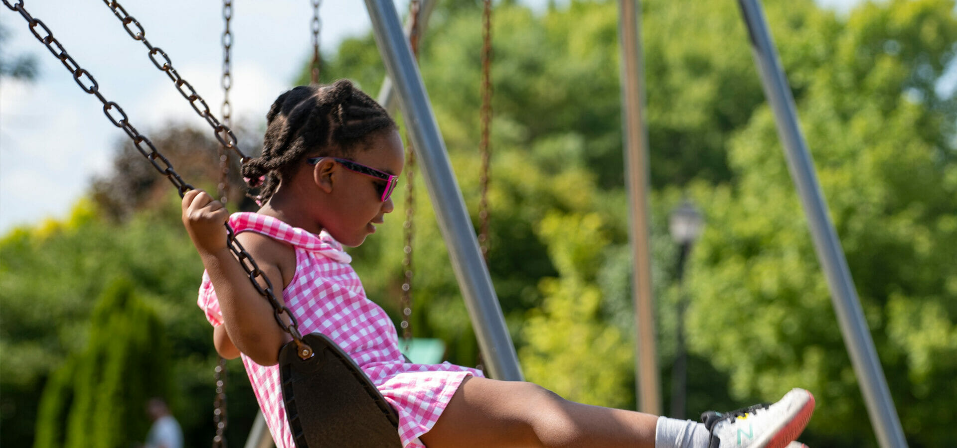 girl playing on swing