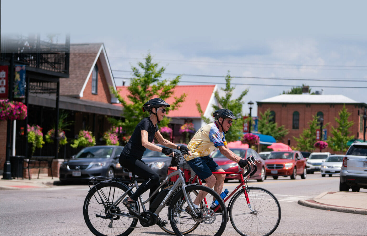 A man and woman riding their bikes in Old Hilliard