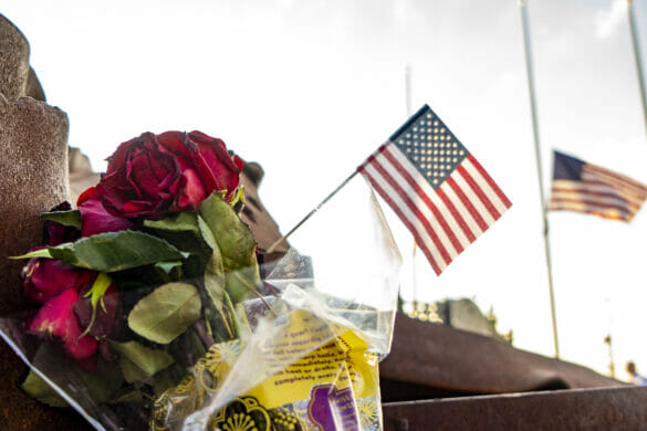 flowers at First Responder's Park with small American flags