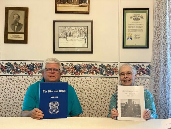 Randy and Marilyn from the historical society holding up information packets.