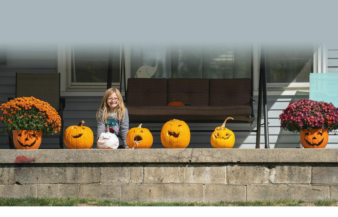Girl posing with pumpkins