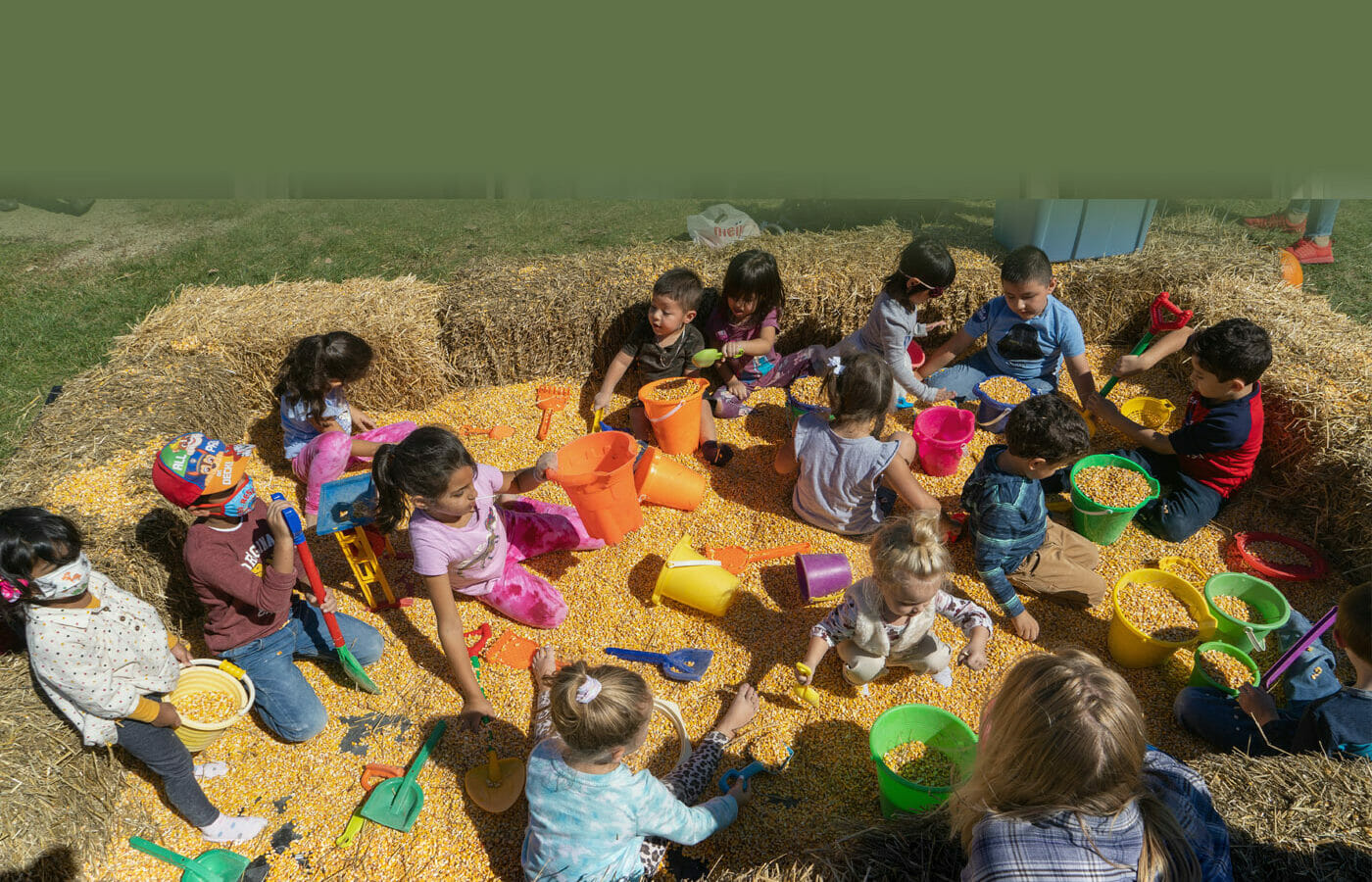 Kids playing in pit of corn